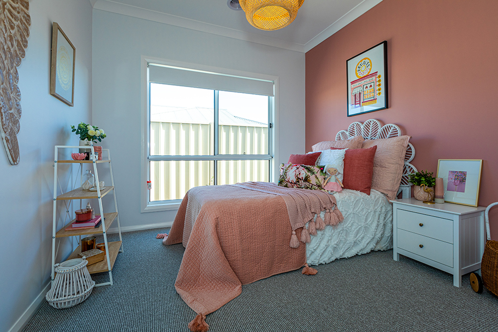Kids bedroom with peach accents